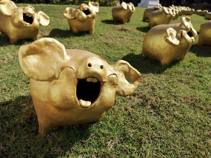Sheep sculpture on field
