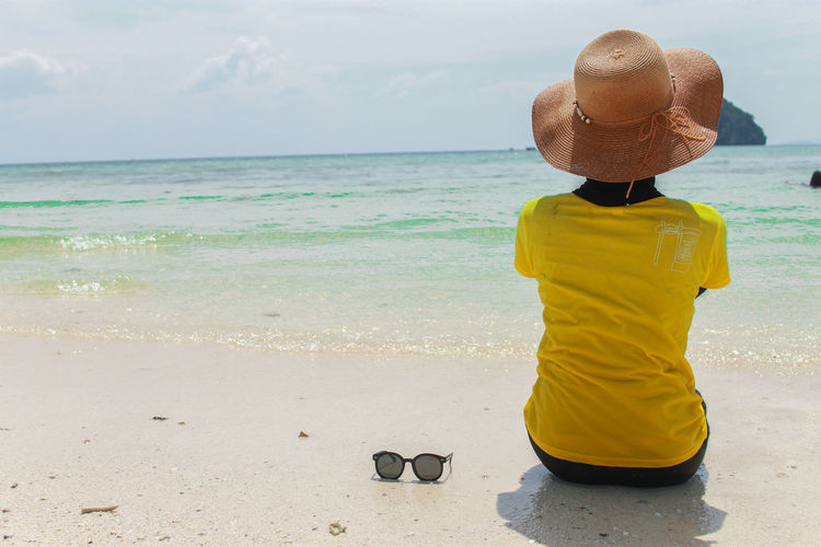 Alone Alone Time Krabi Thailand Beach Beauty In Nature Clothing Day Hat Horizon Horizon Over Water Land Leisure Activity Lifestyles Looking At View Nature One Person Outdoors Real People Rear View Scenics - Nature Sea Sky Sun Hat Tranquil Scene Water