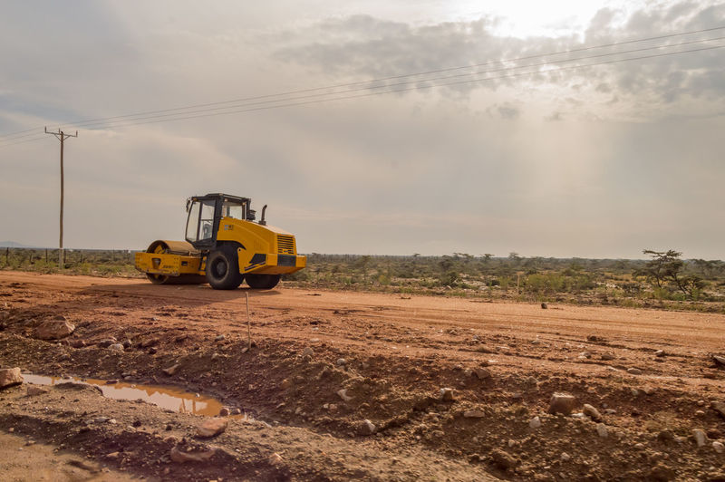 Bulldozer At Construction Site Against Sky