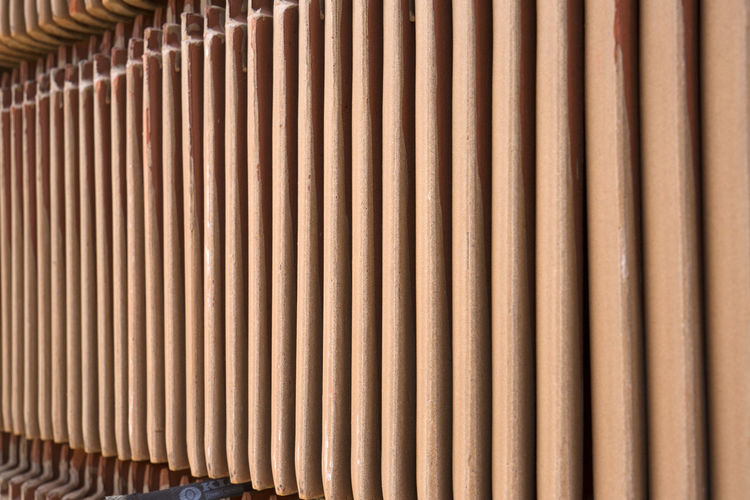 Building Material Backgrounds No People Pattern Full Frame Brown Close-up Repetition Wood - Material Textured  Side By Side Architecture In A Row Large Group Of Objects Indoors  Metal Abundance Design Bamboo - Material Pipe - Tube Corrugated Contruction Zone Material Photography Color Image