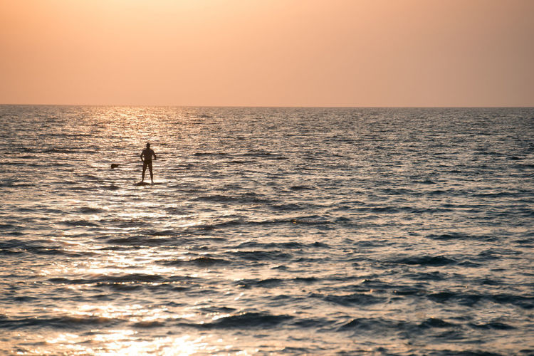 Sirf Beach Beauty In Nature Dramatic Sky Horizon Horizon Over Water Leisure Activity One Man Only One Person Outdoors Scenics Sea Silhouette Sky Summer Sun Sunlight Sunset Sup Tourism Travel Travel Destinations Vacations Water Wave