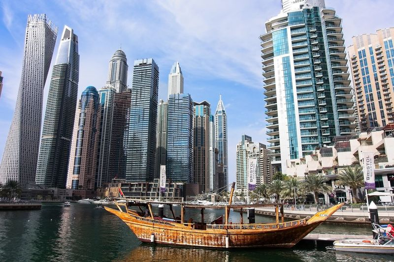 Dubai Marina in a summer day, UAE Building Exterior Built Structure City Architecture Building Office Building Exterior Skyscraper Water Sky Tall - High Modern Tower Urban Skyline Day Office Cityscape No People Outdoors Financial District  Dubai Marina UAE