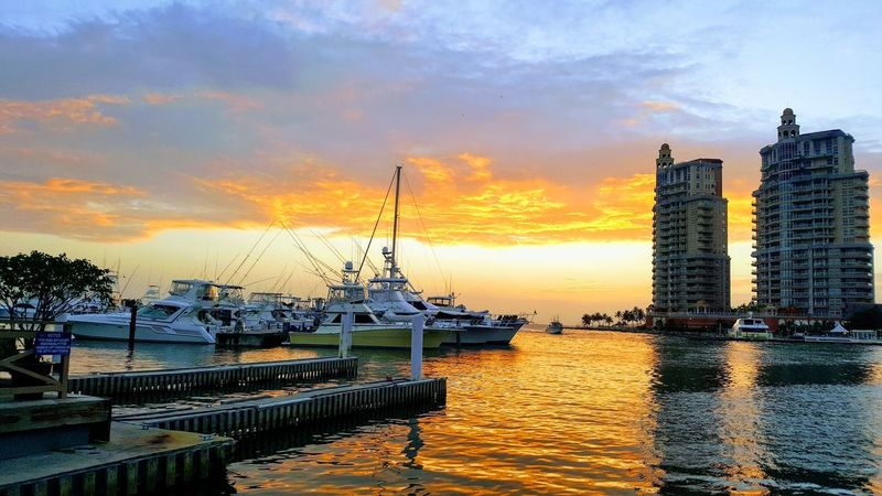 Evening Sky Buildings Boats Docked Boats Dock Bright Reflection On Water Yellow Sunset Cloud - Sky Water Outdoors Sea No People Travel Destinations Beauty In Nature Nautical Vessel Architecture Day Harbor Scenics Orange Color Sky