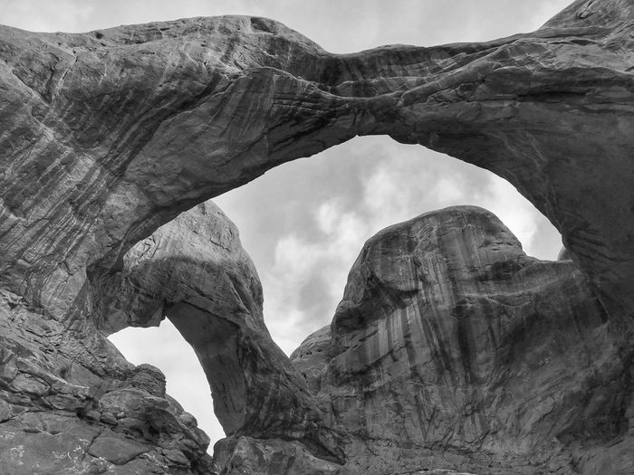 Black and white low angle view of the double arches in arches national park