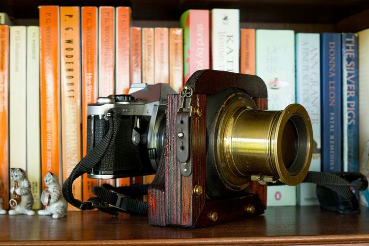 Thought I'd add a photo of my pride and joy as first photo. It's a Petzval formula 1880s Magic Lantern lens that I adapted (using plywood) to K-Mount to fit both my Pentax DSLR and SLR. :) Pentax PENTAX K-1 Pentax Me Super Pentaxian Petzval Petzval Lens Antique Antique Lens DIY DIY Lens Books Bookshelf Bookshelfporn Indoors  Arts Culture And Entertainment Old-fashioned No People Timetravel First Eyeem Photo