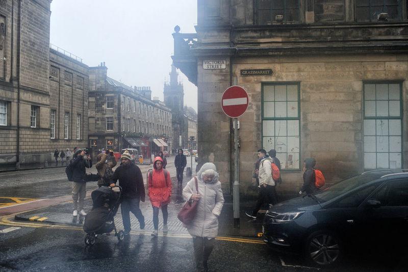 People on city street during rainy season