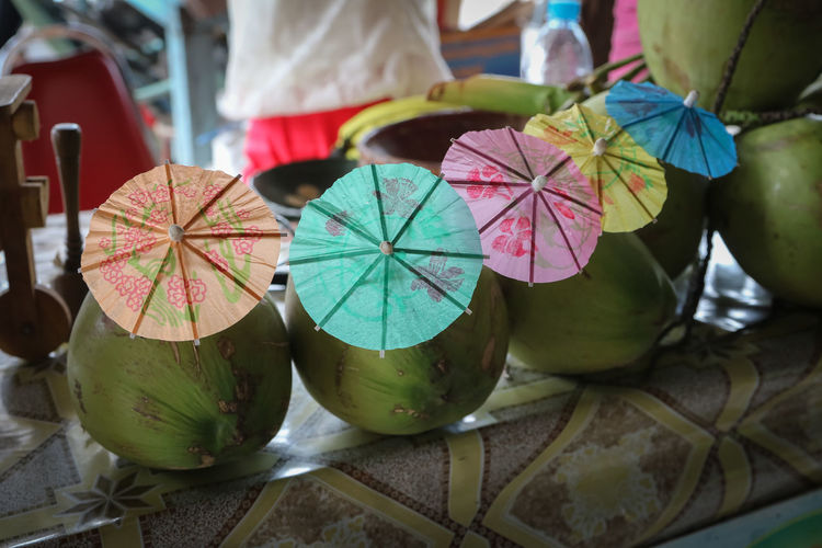 Close-up of coconut drinks in row