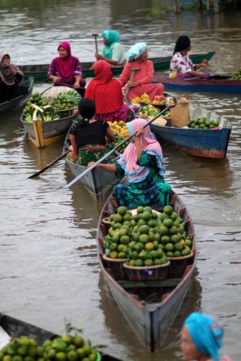 Floating Market People River Water Real People Men Food Fruit Day Selling Outdoors Hat Transportation Food And Drink Group Floating Market Adult Healthy Eating Group Of People Nautical Vessel Medium Group Of People Mode Of Transportation