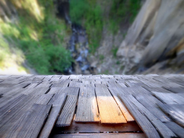 Dizzy Down To The River Focus On Foreground No People Outdoors Selective Focus Valley Floor View From Above View From Bridge Wood Slats Wooden Bridge