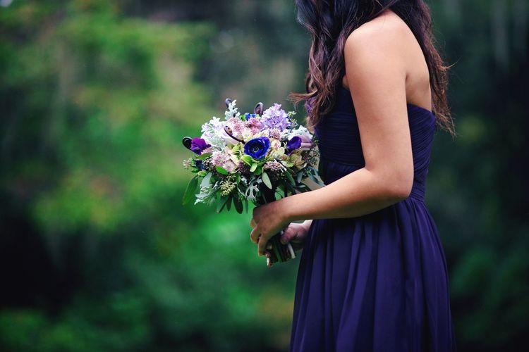 Side View Of Women Holding Flower Bouquet