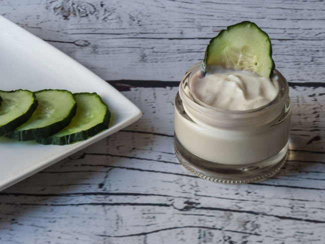 cucumber face cream on white wooden background Anti-wrinkle Cream Cosmetics & Glamour Cucumber Handmade Cosmetics Homemade Food Homemade Cosmetic Natural Cosmetics Natural Products Youth Alternative Alternative Cosmetics Anti Age Anti Aging Cream Antiallergic Cosmetics Cucumber Cream Ecology Ecology Cosmestics Face Cream Hand Cream Handmade Rejuvenating Rejuvenating Cream Skin Care Skin Cosmetics