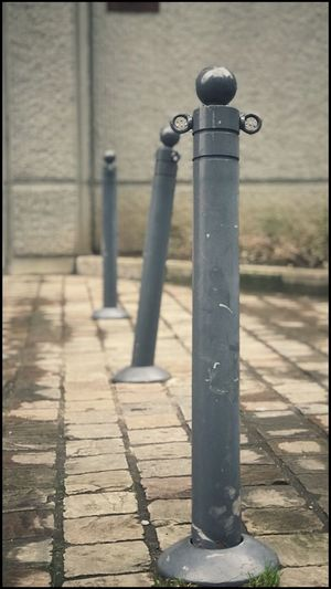 Kris Demey Photography Day Metal Footpath Shadow No People Sunlight Bollard Focus On Foreground Outdoors Sidewalk Close-up Pole City Street Protection Post Safety Security