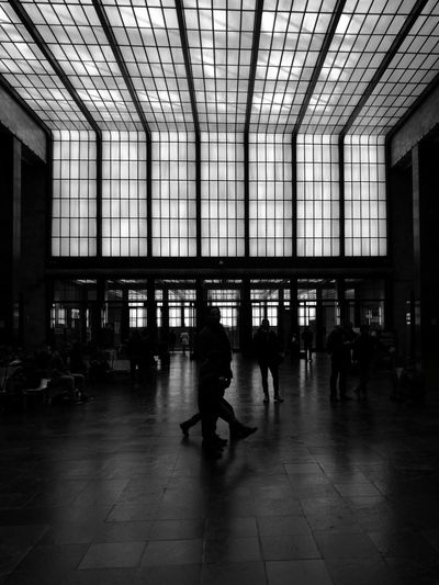 Nowhere, Indoors  Lifestyles Architecture Built Structure Real People Ceiling Large Group Of People People Railroad Station Waiting Room Black And White Photography Welcome To Black Art Is Everywhere The Architect - 2017 EyeEm Awards Black And White Friday EyeEm Ready   The Graphic City Stories From The City Adventures In The City