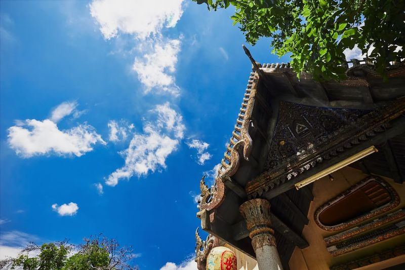 Thai temple Low Angle View Sky Built Structure Architecture Cloud - Sky Day Building Exterior Blue Religion Spirituality Outdoors Sunlight Place Of Worship Travel Destinations Nature Temple Thailand Buddhism Art And Craft Tree Traditional Culture The Week On EyeEm