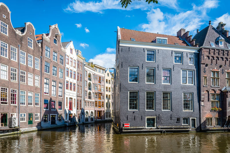 Amsterdam cityscape with canals in Red Light District Amsterdam Architecture Building Exterior Business Finance And Industry City Cityscape Day Multi Colored No People Outdoors Red Light District Sky Tourism Travel Travel Travel Destinations Water