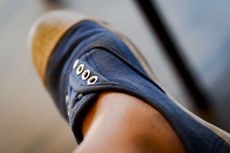 Low section of person wearing canvas shoes