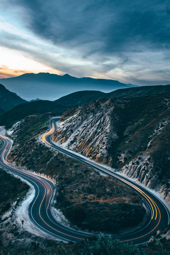 Dynamic Roads Beauty In Nature Cloud - Sky Curve Environment High Angle View Landscape Mountain Mountain Range Mountain Road Nature No People Non-urban Scene Outdoors Road Scenics - Nature Sky Tranquil Scene Tranquility Transportation Winding Road