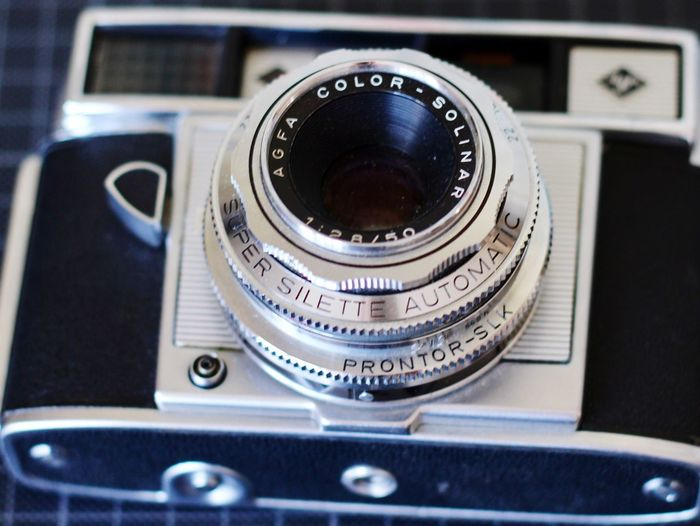 EyeEm Selects Lens - Optical Instrument Camera - Photographic Equipment Photography Themes Technology Still Life Old-fashioned Film Reel Selective Focus Close-up Retro Styled Film Industry No People Indoors  Antique Camera Photograph Movie Camera Day