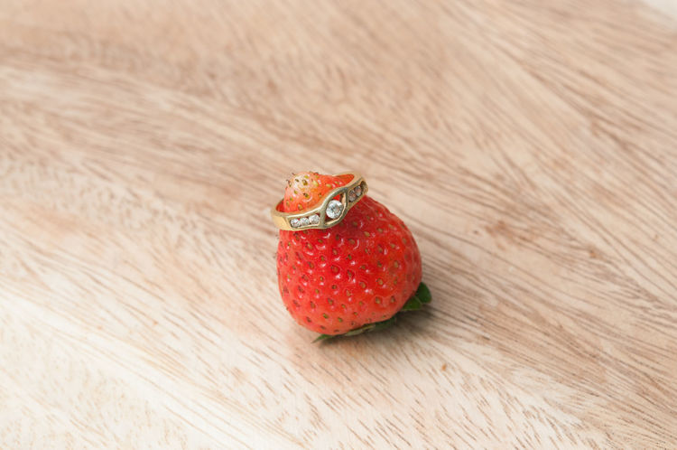 wedding ring on strawberry Close-up Day Food Food And Drink Freshness Fruit Healthy Eating Indoors  Marry No People Ready-to-eat Red Ring Strawberries Strawberry Table Wood - Material