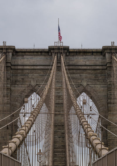 Brooklyn Bridge Brooklyn Brooklyn Bridge  New York New York City Architecture Bridge Bridge - Man Made Structure Built Structure City Connection Day Daylight Flag Outdoors Sky Stone Tourism Transportation Travel Travel Destinations EyeEmNewHere EyeEmNewHere Adventures In The City The Architect - 2018 EyeEm Awards My Best Photo