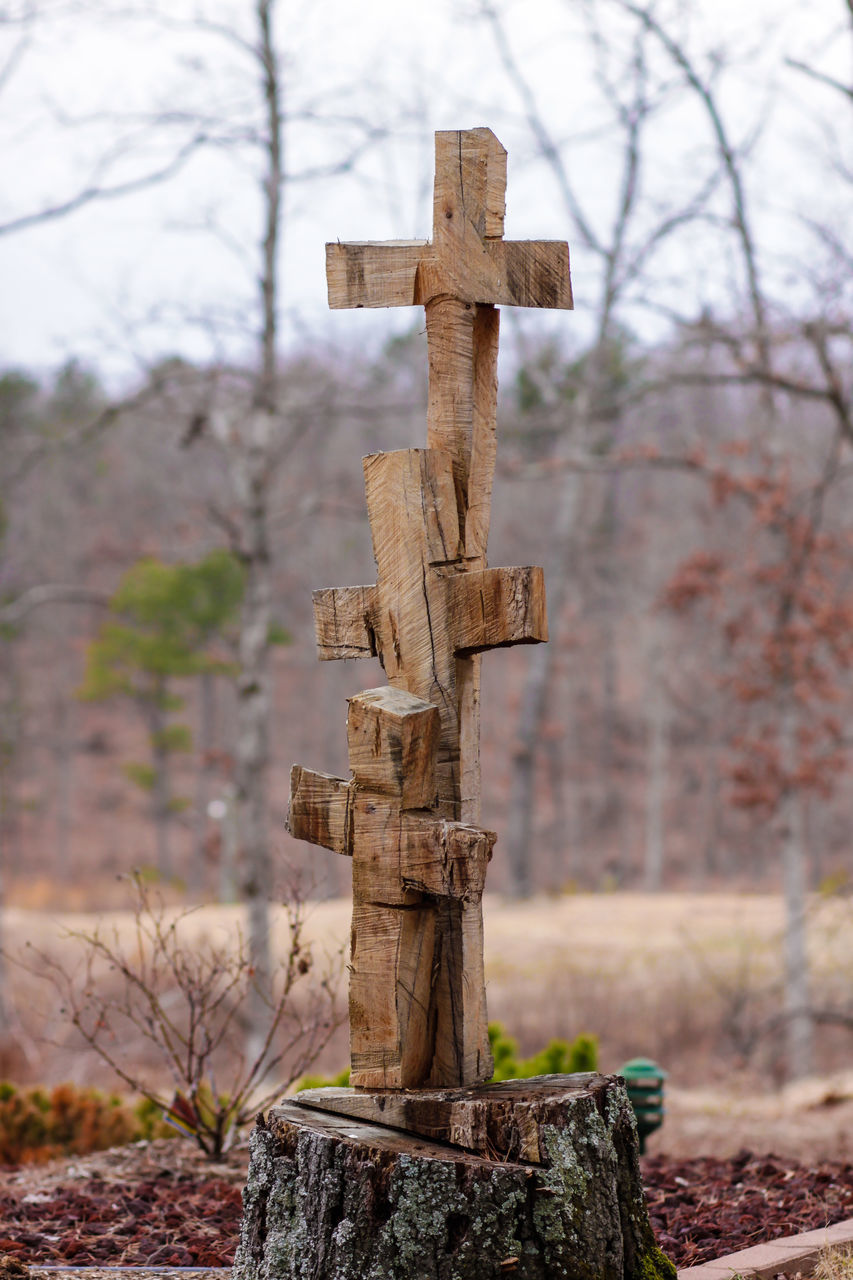 Close-Up Of Cross On Cemetery Against Sky