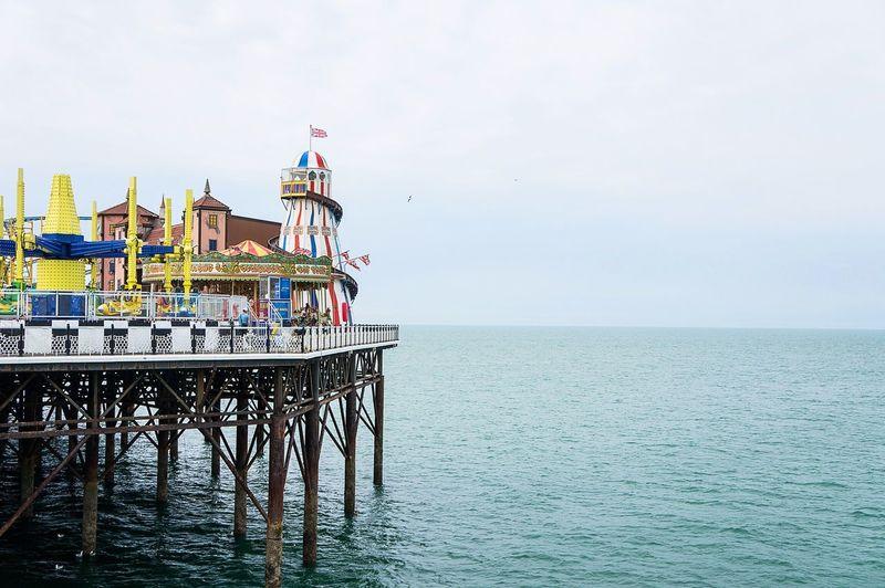 Brighton pier over sea against sky