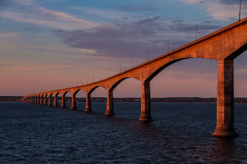 Confederation Bridge at sunset, Canada. The colour of the sunset reflecting off the concrete. Linking Prince Edward Island and New Brunswick Architecture Confederation Bridge Fixed Link New Brunswick Architecture Bridge Bridge - Man Made Structure Canada Coast To Coast Connection Engineering Prince Edward Island Sea Sunset Transportation Water