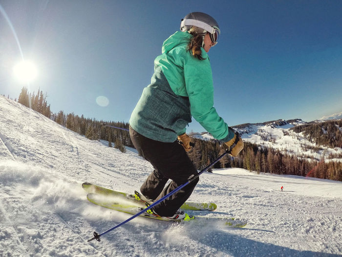 Ski Skier Snowskiing Turning Outdoors Outdoor Activity Adventure Woman Athlete Wintertime Wintersport Warm Clothing Snow Winter Mountain Women Sport Cold Temperature Young Women Full Length Headwear Ski Holiday Ski Jacket Skiing Ski Resort  Winter Sport Ski Slope Skiing Helmet Ski Track Powder Snow International Women's Day 2019