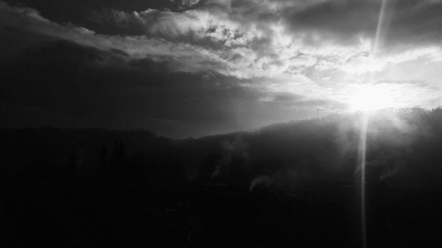 Silhouette landscape against sky