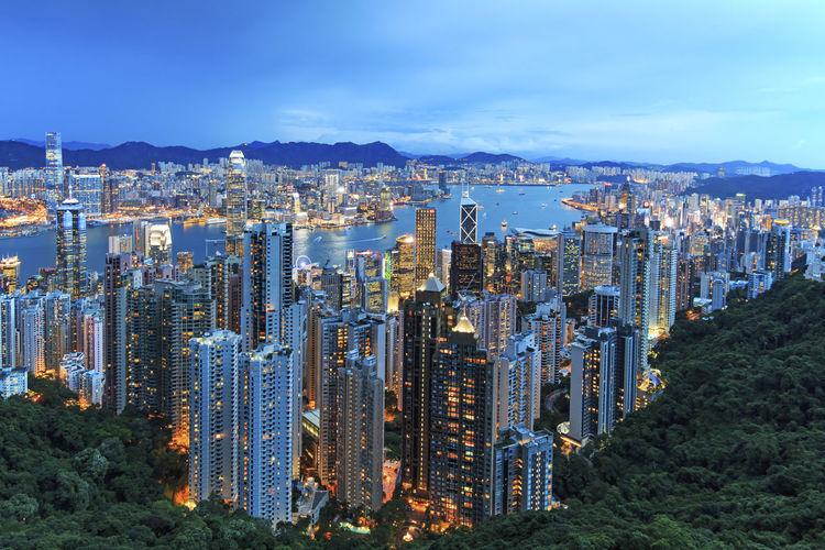 Illuminated two international finance center in city seen from victoria peak