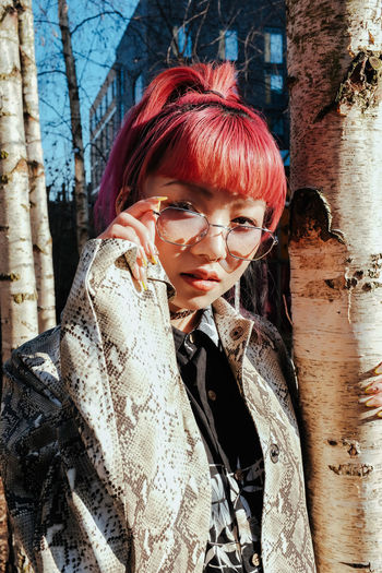 International Women's Day 2019 One Person Young Adult Portrait Real People Lifestyles Young Women Looking At Camera Leisure Activity Redhead Glasses Fashion Beautiful Woman Front View Adult Women Beauty Clothing Dyed Hair Hairstyle Bangs Outdoors Warm Clothing Contemplation Dyed Red Hair