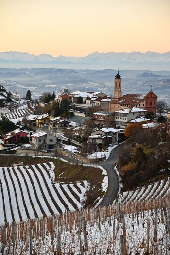 Villagescape Snowed Village Langhe Landscape Snowed Landscape Tranquility Beauty In Nature Hills Top Of The Hills Vineyards  Vineyards In Winter Outdoor Travel Snowscape Snowed Vineyard Frozen Scenicsunset Winter Sunset Outdoors Travel Destinations No People Architecture Sunset Day Sky