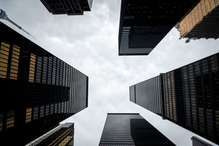 Directly Below View Of Skyscrapers Against Sky In City