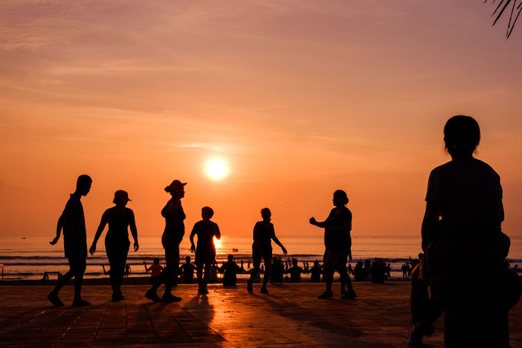 Sunset Group Of People Sky Orange Color Silhouette Sea Real People Men Beach Lifestyles Leisure Activity Water Land Beauty In Nature Scenics - Nature Nature People Crowd Horizon Over Water Outdoors Dawn Of A New Day The Art Of Street Photography