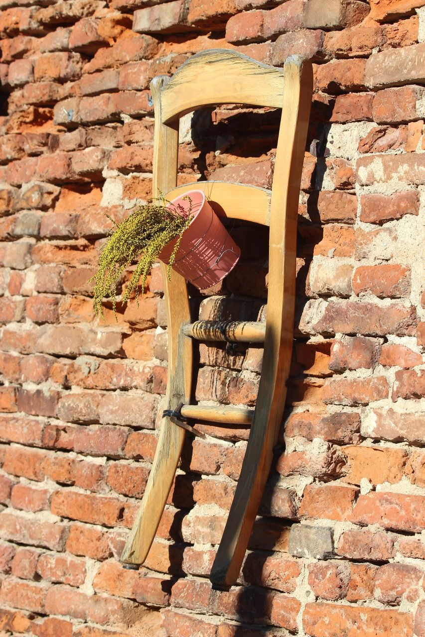 LOW ANGLE VIEW OF OLD WALL AND BRICK ON STONE WALLS