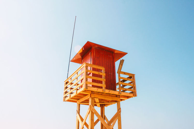 Low angle view of a lifeguard hut against blue sky