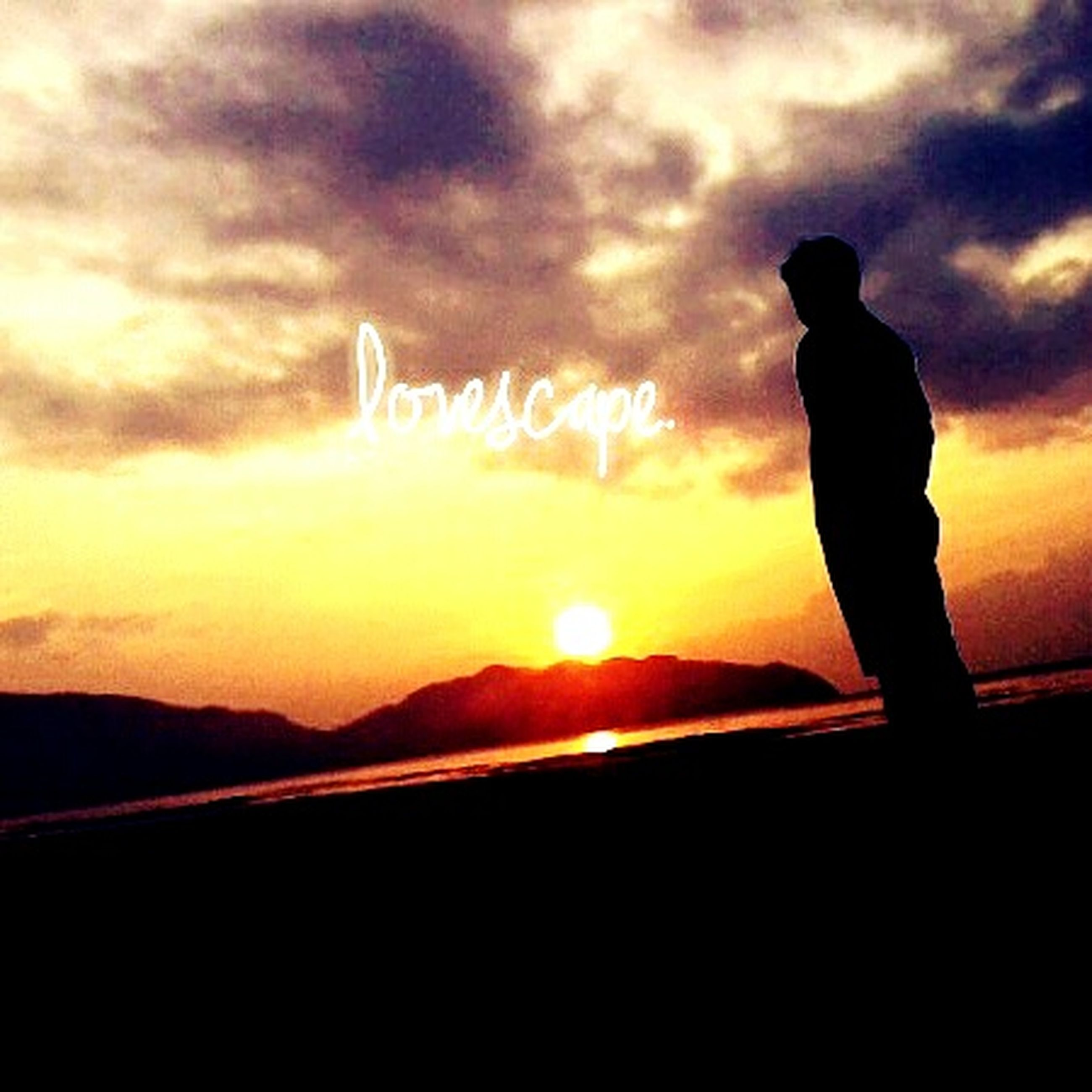 silhouette, sunset, men, standing, scenics, tranquility, tranquil scene, cloud - sky, idyllic, mountain, sky, nature, getting away from it all, beauty in nature, outdoors, solitude, outline, cloud, dramatic sky, orange color, atmospheric mood, sun, mountain peak, remote, carefree, escapism, non-urban scene, cliff