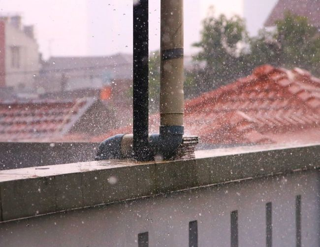Close-up of wet window in rainy season