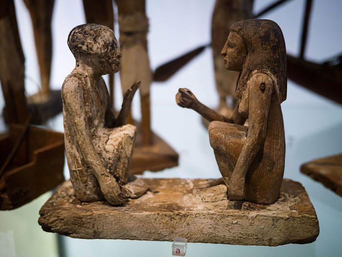Wooden seated figures from ancient Egypt. They would have been in a tomb, carrying out a task to help keep the deceased nourished in the afterlife, such as grinding grain, making beer or butchering a slaughtered animal. Ancient Ancient Civilization Ancient Egypt Close-up Egyptology Manchester Museum Old Tomb Model Wood Wooden