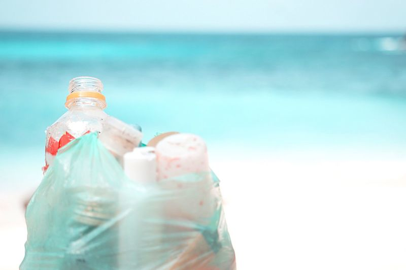 Close-up of water bottle on beach