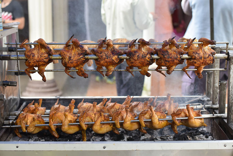 Grilling whole chicken Barbecue Food Food And Drink Meat Fried Outdoors Day Chinese Food Heat - Temperature Freshness