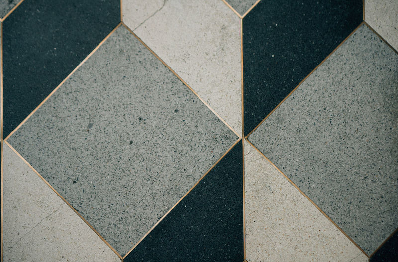 Tile Pattern High Angle View Geometric Shape Shape Full Frame Flooring No People Backgrounds Day Tiled Floor Design Gray Textured  Marble Close-up Square Shape Outdoors Triangle Shape Footpath Concrete