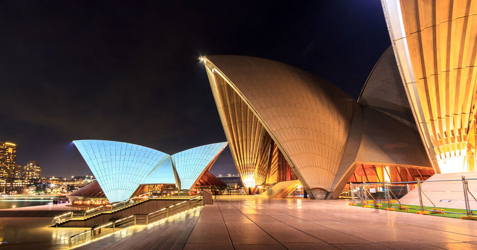 Night shot of the Sydney Opera House from the side, facing the city Modern Architecture Sydney Opera House Architecture Building Exterior Built Structure City Cityscape Concert Hall  Illuminated Modern Night No People Outdoors Sky Travel Travel Destinations Vacations