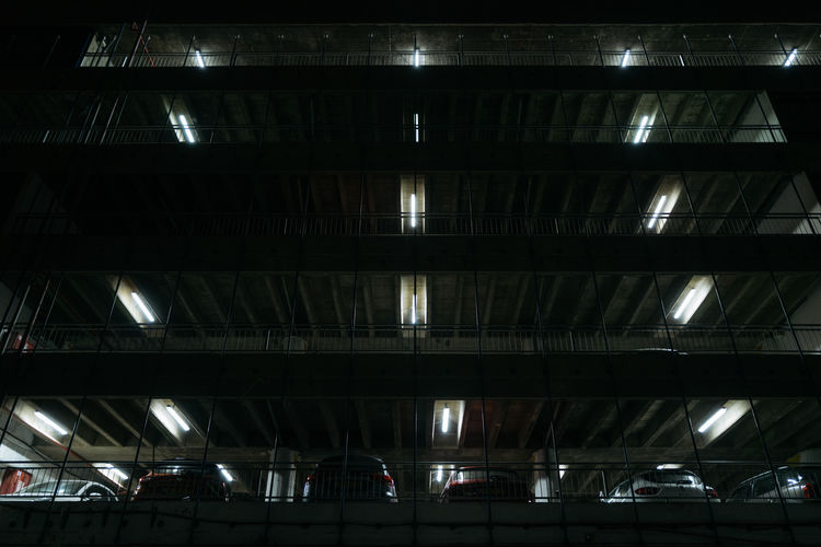 Low angle view of illuminated building at railroad station