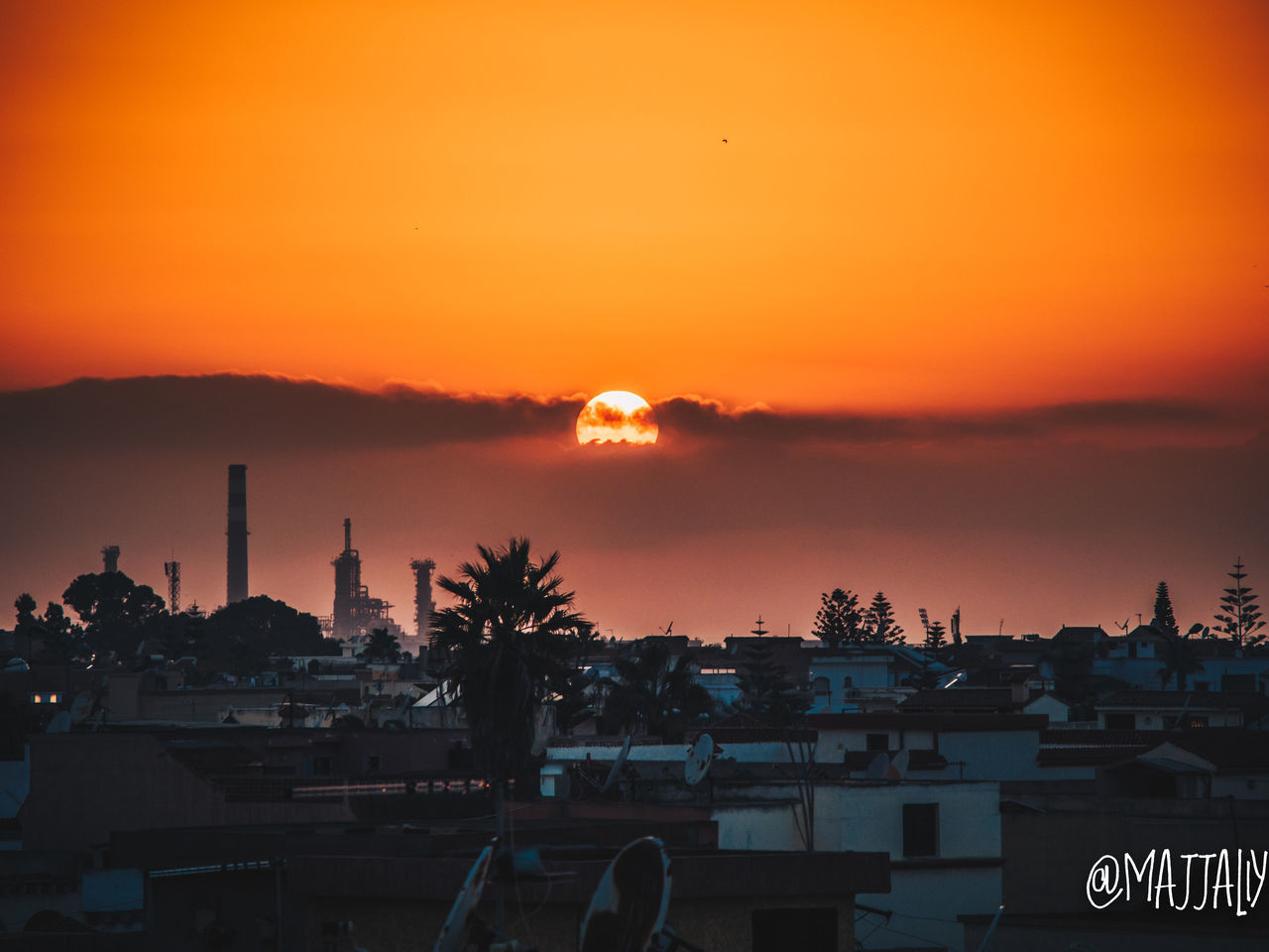 sunset, sky, orange color, architecture, building exterior, built structure, silhouette, nature, water, beauty in nature, no people, cloud - sky, city, scenics - nature, building, religion, belief, outdoors, place of worship, romantic sky