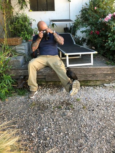 Man sitting on bench in yard