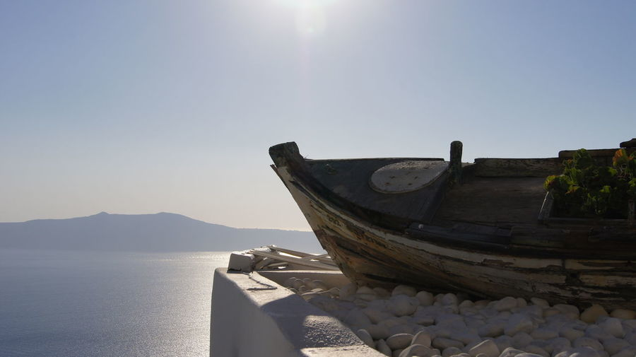 sea water no people Sunlight outdoors Nature day Clear sky beauty in Nature sky The Week on EyeEm Editor's Picks Sea Water No People Sunlight Outdoors Nature Day Clear Sky Beauty In Nature Sky Travel Minimalism Pastel Aesthetics Boat Greece Santorini Island