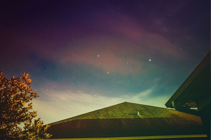 Low angle view of built structure against sky at night