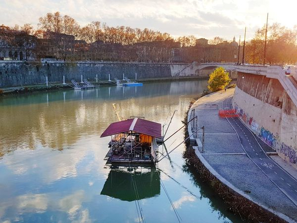 Flying over the river Rome Italy Reflections Graffiti Bike Lane Dome Trees Red Tree Yellow Glowing Sunlight Sunlight And Shadow Tranquil Scene Travel Destinations Samsungphotography Water Reflections Cloud - Sky Sunset Rome River Water Lake Outdoors Nature Scenics Day Sky Nautical Vessel No People
