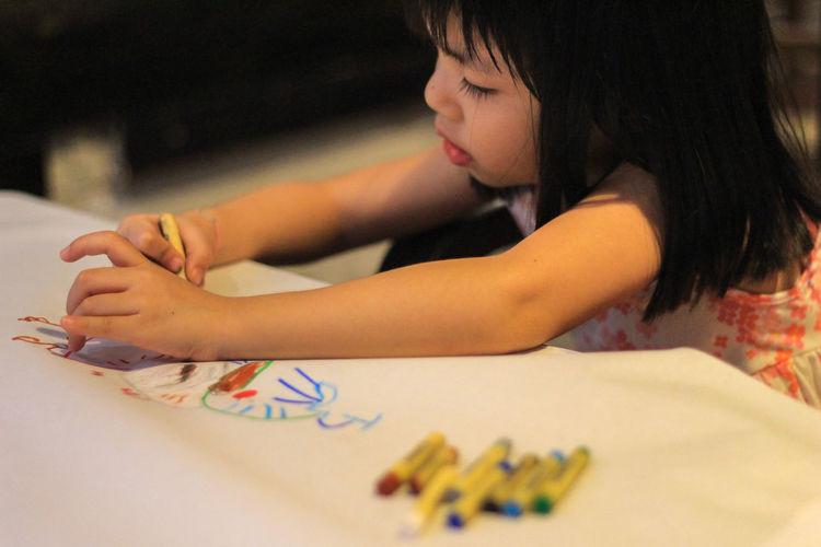 Close-up of girl drawing